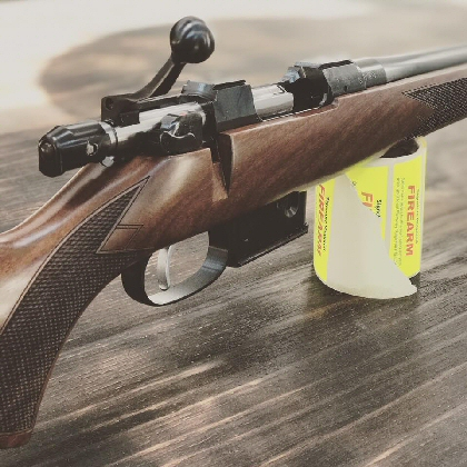 Nice walnut, a genuine mini mauser style, controlled feed action